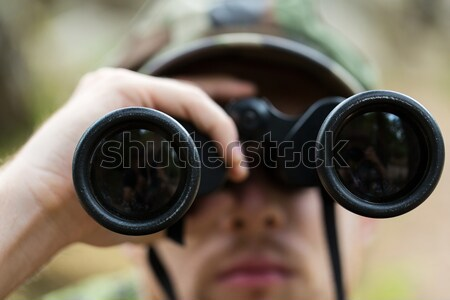 close up of soldier or hunter with binocular Stock photo © dolgachov