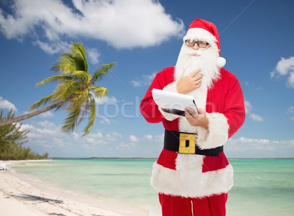 Homem traje papai noel bloco de notas natal férias Foto stock © dolgachov
