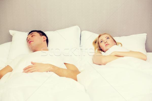 happy couple sleeping in bed Stock photo © dolgachov