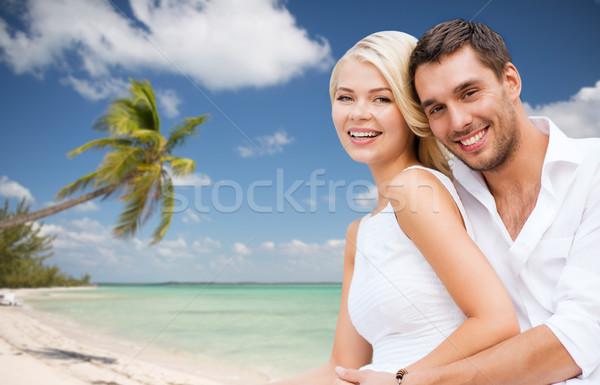 couple having fun and hugging on beach Stock photo © dolgachov