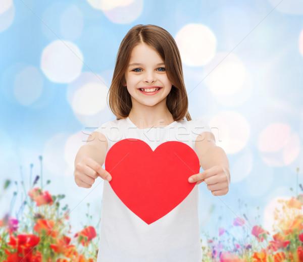 Mosolyog kislány piros szív szeretet jótékonyság Stock fotó © dolgachov