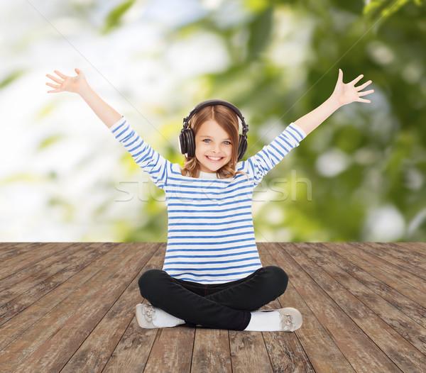 幸せな女の子 ヘッドホン 音楽を聴く 音楽 幼年 人 ストックフォト © dolgachov