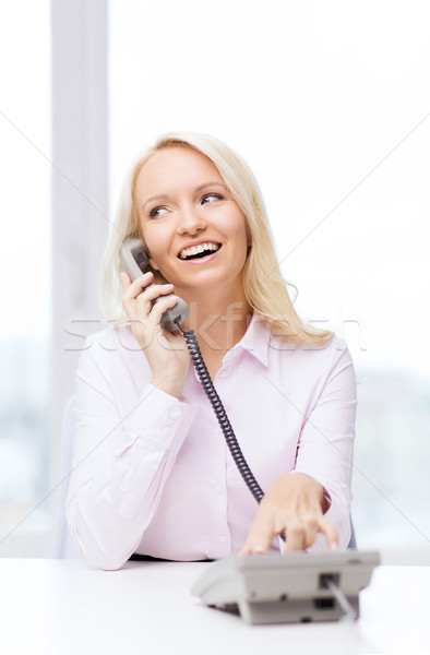 Stock photo: smiling businesswoman or student calling on phone