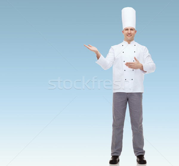 happy male chef cook inviting Stock photo © dolgachov