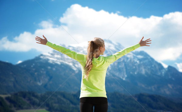 happy woman in sportswear enjoying sun and freedom Stock photo © dolgachov