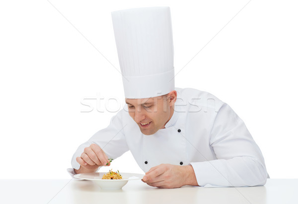happy male chef cook decorating dish Stock photo © dolgachov