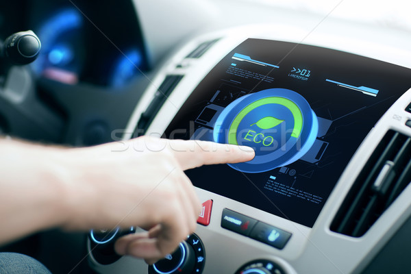 male hand setting car eco system mode on screen Stock photo © dolgachov