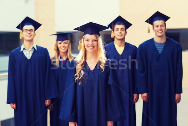 Groep glimlachend studenten onderwijs afstuderen mensen Stockfoto © dolgachov