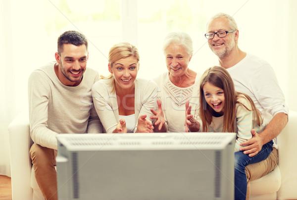 Boldog család néz tv otthon család boldogság Stock fotó © dolgachov