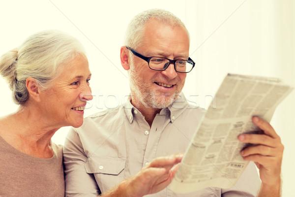happy senior couple reading newspaper at home Stock photo © dolgachov