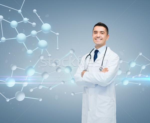 Uśmiechnięty mężczyzna lekarz wzoru chemia biologii ludzi Zdjęcia stock © dolgachov