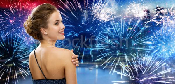 Gelukkig vrouw avondkleding stad vuurwerk mensen Stockfoto © dolgachov