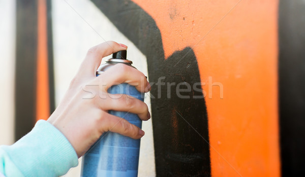 close up of hand drawing graffiti with spray paint Stock photo © dolgachov
