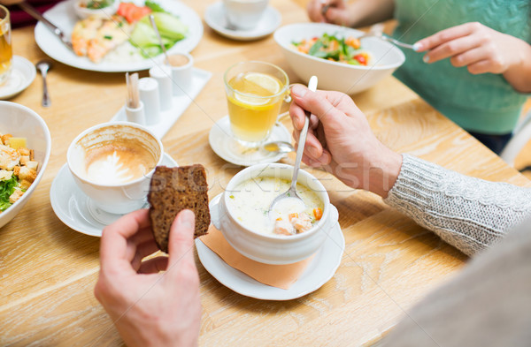 close up man eating soup for dinner at restaurant Stock photo © dolgachov