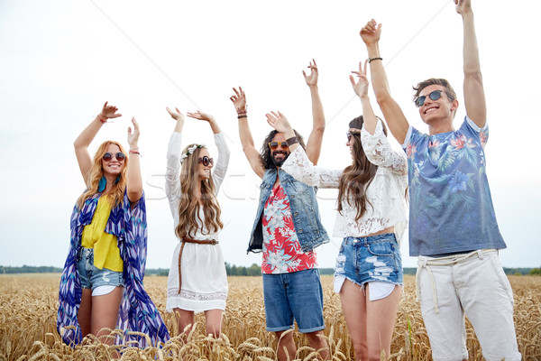 happy young hippie friends dancing outdoors Stock photo © dolgachov