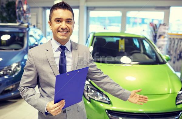 Feliz hombre auto mostrar coche salón Foto stock © dolgachov