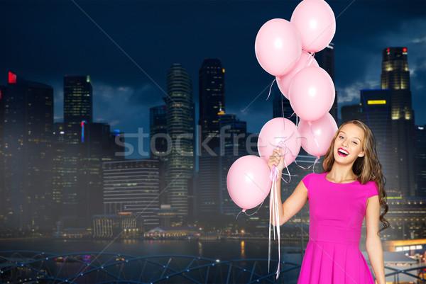 Feliz mulher jovem balões noite cidade pessoas Foto stock © dolgachov