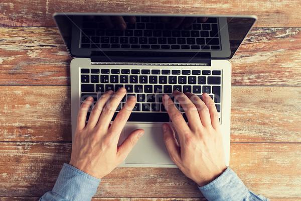 Közelkép férfi kezek laptop gépel üzlet Stock fotó © dolgachov