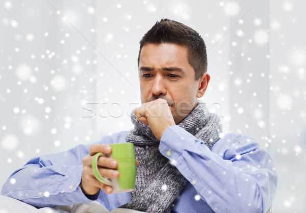 Beteg férfi influenza iszik tea köhögés Stock fotó © dolgachov