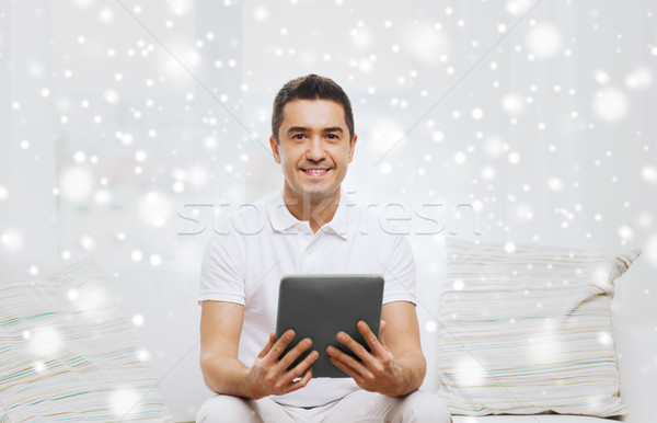 smiling man working with tablet pc at home Stock photo © dolgachov