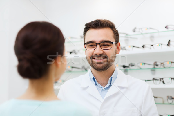 woman and optician in glasses at optics store Stock photo © dolgachov