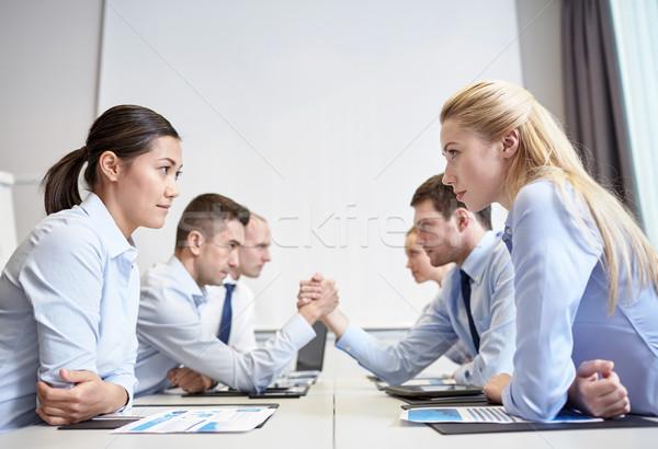 笑みを浮かべて ビジネスの方々  紛争 オフィス 危機 対決 ストックフォト © dolgachov
