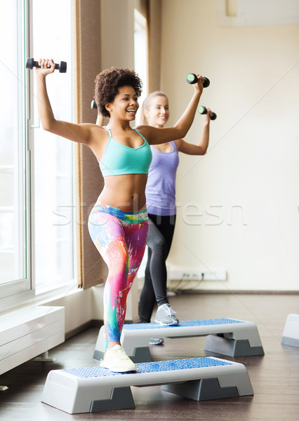 group of women with dumbbells and steppers Stock photo © dolgachov