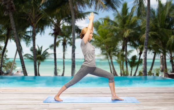 Femme yoga guerrier posent fitness Photo stock © dolgachov
