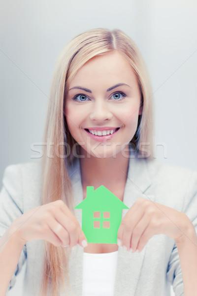 woman with illustration of eco house Stock photo © dolgachov
