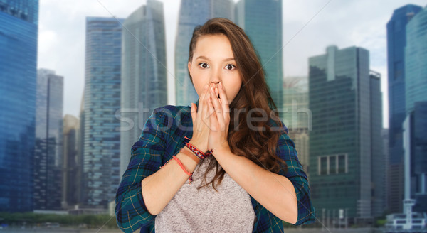scared teenage girl over singapore city background Stock photo © dolgachov