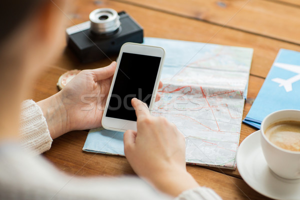 close up of traveler hands with smartphone and map Stock photo © dolgachov