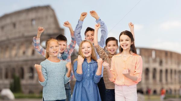 happy children celebrating victory over coliseum Stock photo © dolgachov