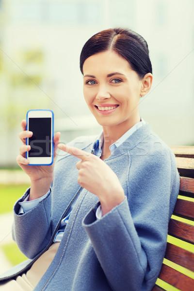 Giovani sorridere imprenditrice smartphone uomini d'affari Foto d'archivio © dolgachov