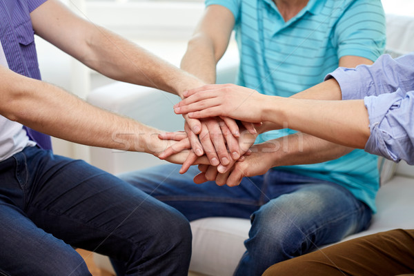 close up of friends connecting hands together Stock photo © dolgachov