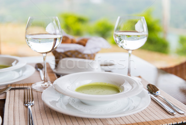 close up of soup and water glasses at restaurant Stock photo © dolgachov