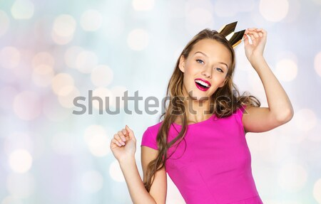Stock photo: happy young woman or teen girl in pink dress