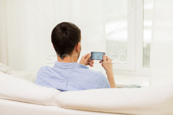 close up of man with smartphone at home Stock photo © dolgachov