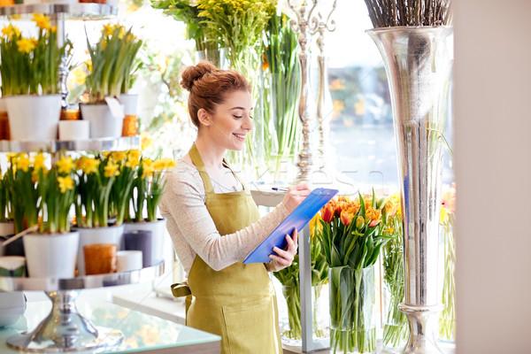 花屋 女性 クリップボード 花屋 人 販売 ストックフォト © dolgachov