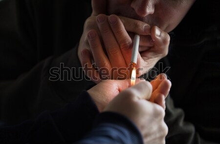 close up of addict smoking marijuana joint Stock photo © dolgachov