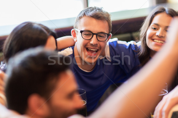 football fans or friends with beer at sport bar Stock photo © dolgachov