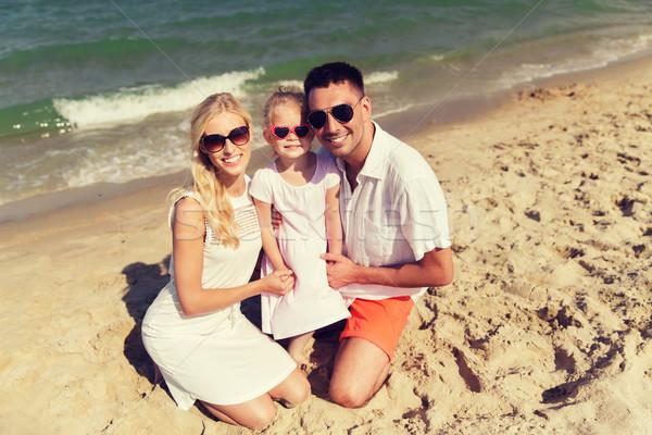 happy family in sunglasses on summer beach Stock photo © dolgachov