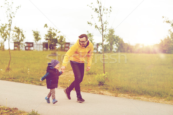 happy father and little son walking outdoors Stock photo © dolgachov