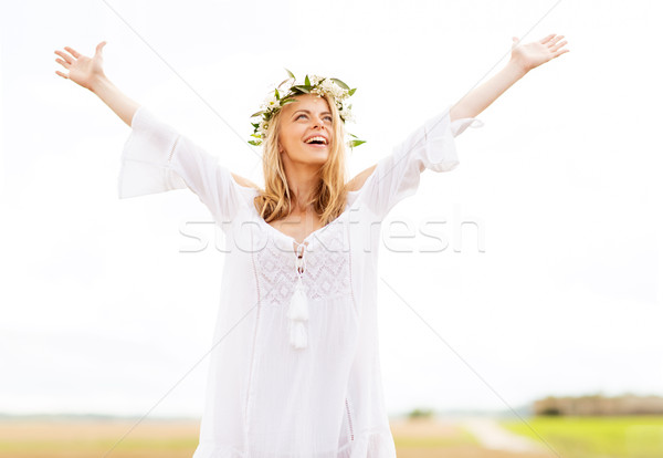 Stock photo: happy young woman in flower wreath on cereal field