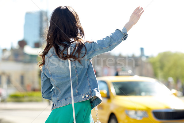девушки такси городской улице жест транспорт Сток-фото © dolgachov