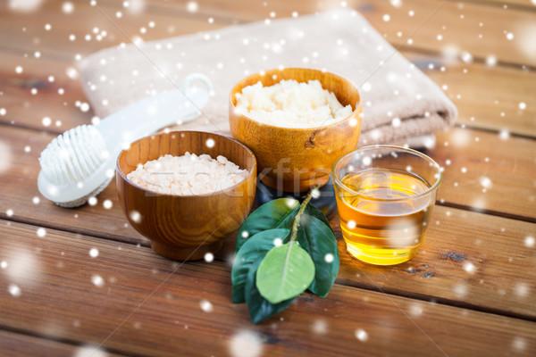 himalayan pink salt, body scrub, brush and honey Stock photo © dolgachov