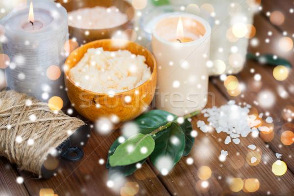 natural body scrub and candles on wood Stock photo © dolgachov