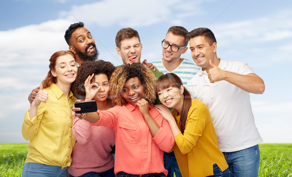 group of people taking selfie by smartphone Stock photo © dolgachov