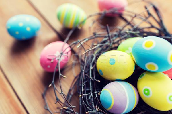 Gekleurd paaseieren nest hout Pasen Stockfoto © dolgachov