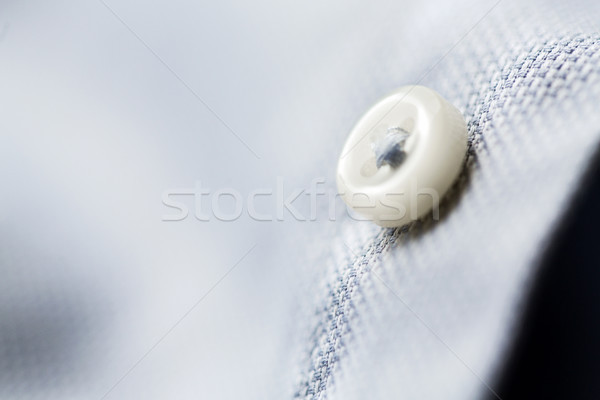 close up of blue shirt button Stock photo © dolgachov