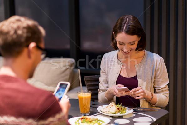 happy couple having dinner at vegan restaurant Stock photo © dolgachov